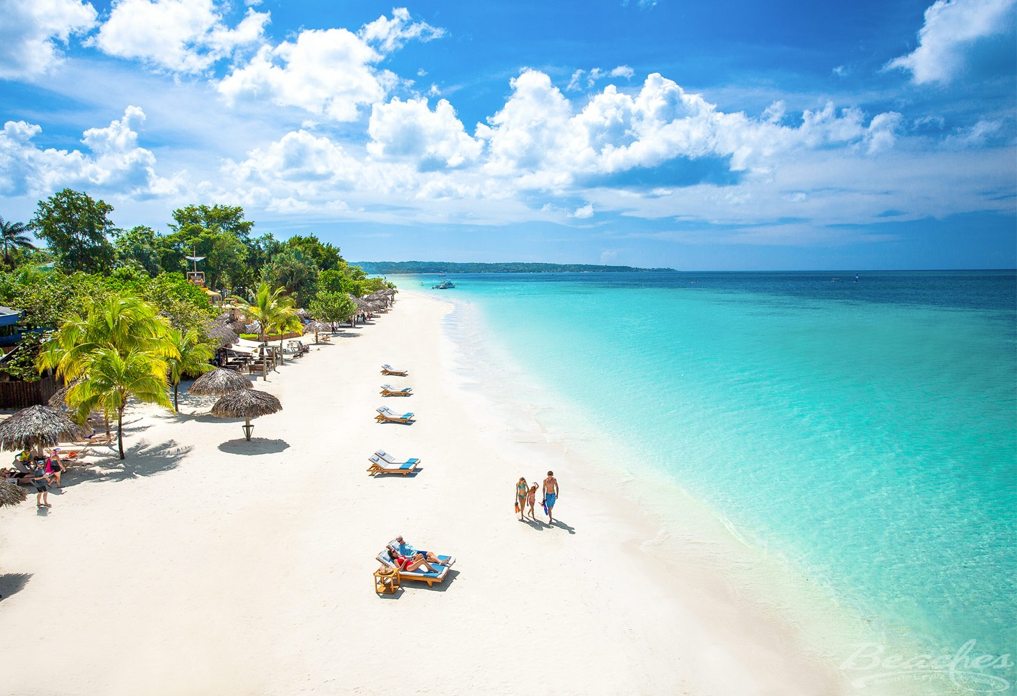 Family walking on Beaches Negril Resort & Spa