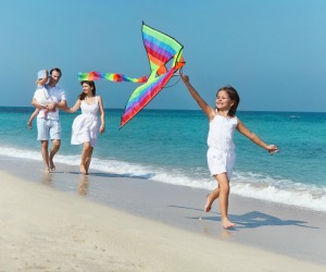 Flying a kite on the beach in Southwest Florida is fun for the whole family